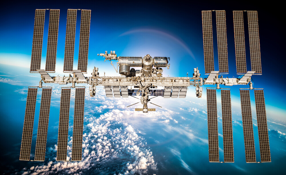 International Space Station in orbit; planet earth in background.