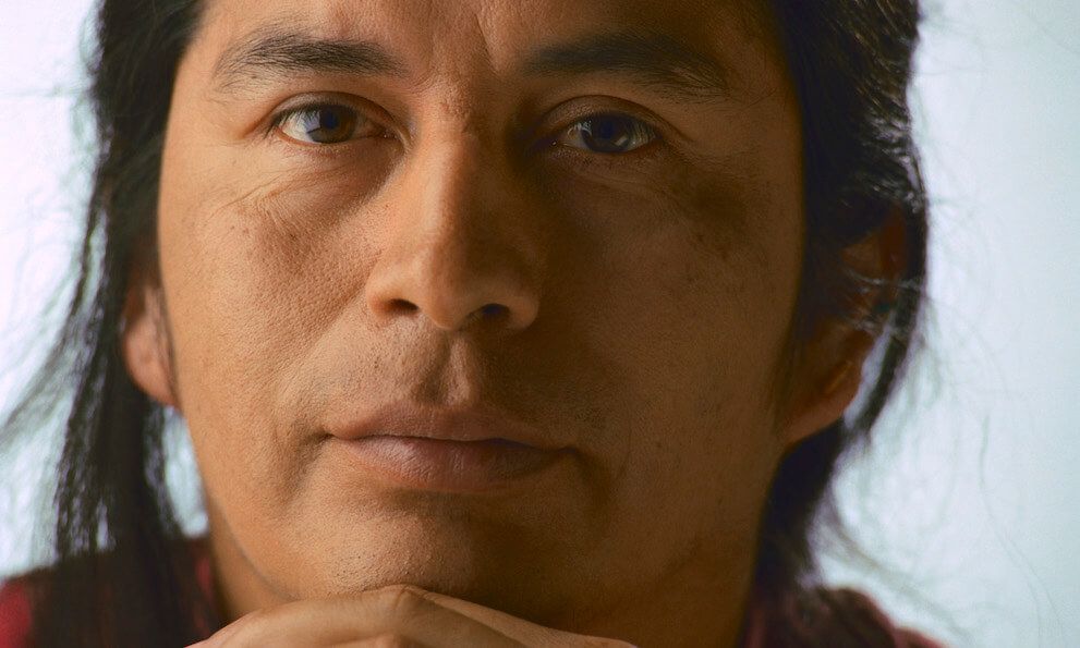 close-up of a Native American man looking serious and thoughtful