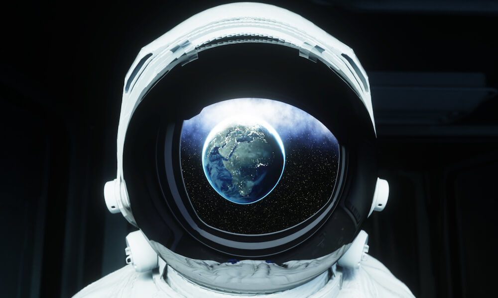 Astronaut in space with earth reflected in visor