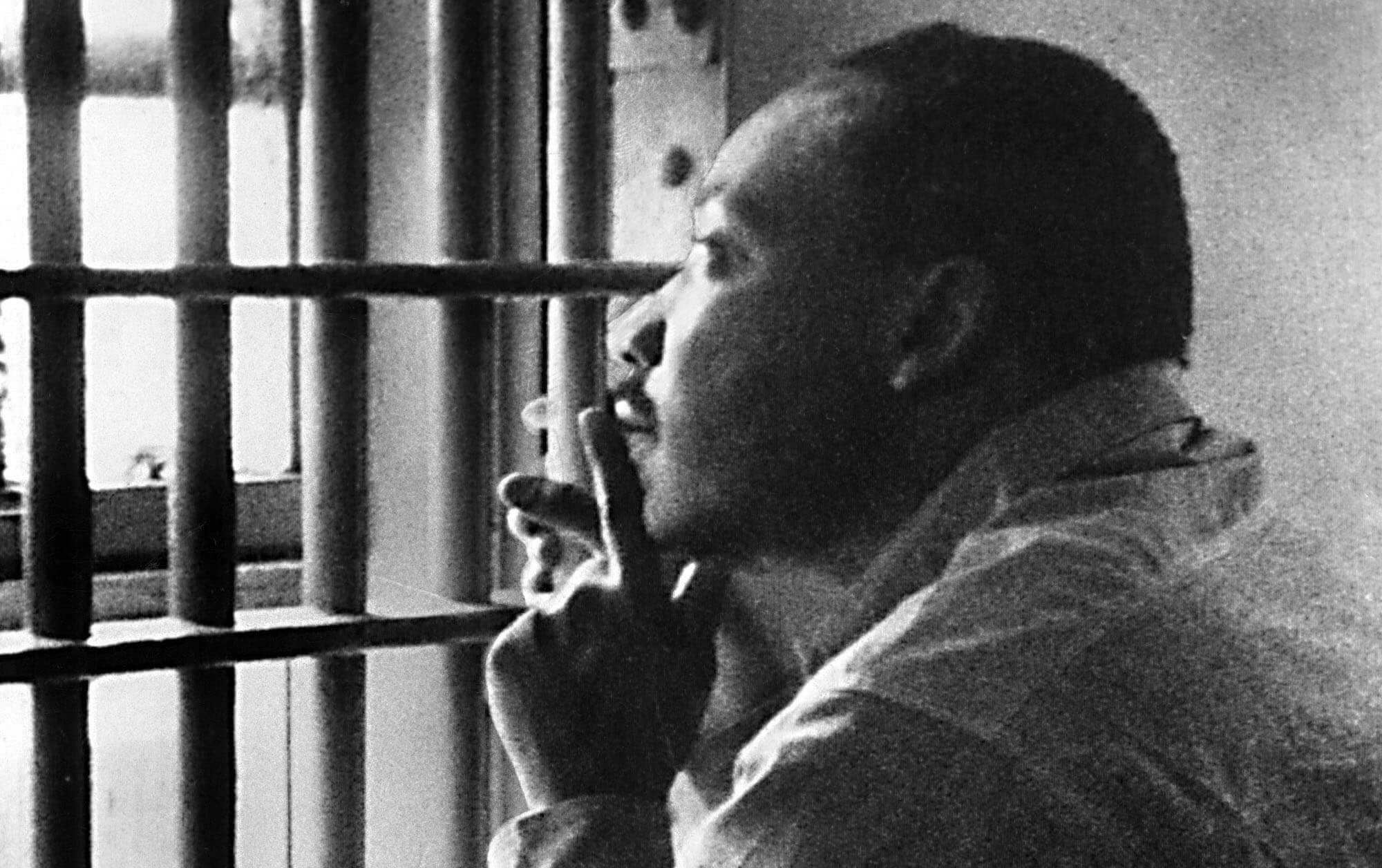 MLK sitting in a prison cell