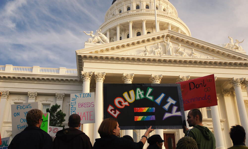 Protestors holding signs in front of the U.S. Capitol building