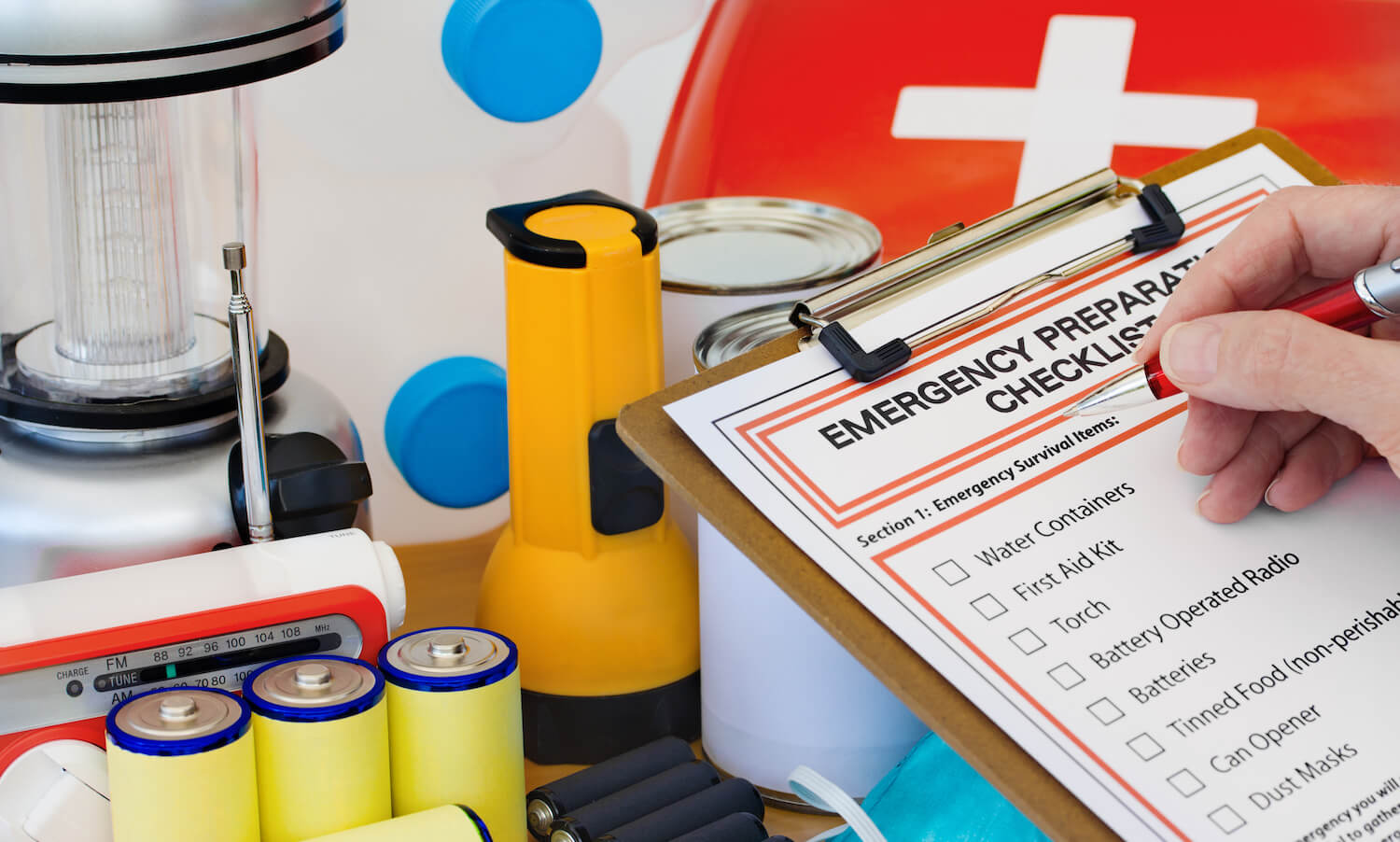 hand checking emergency preparation list and equipment