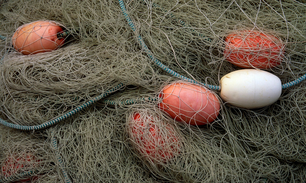 pile of fishing nets and floats