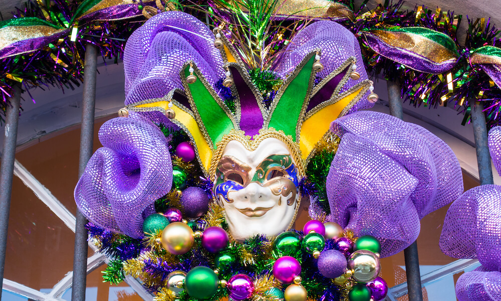 Mardi Gras mask and ornaments on a door in New Orleans, Louisiana.