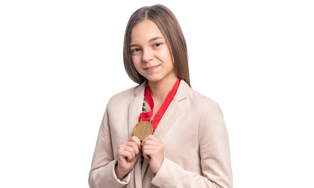 Happy award winner wearing her medal