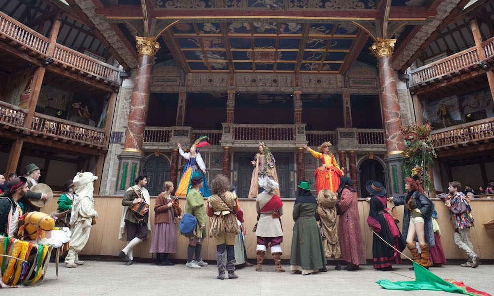 Interior of Shakespeare's Globe Theatre with actors on stage