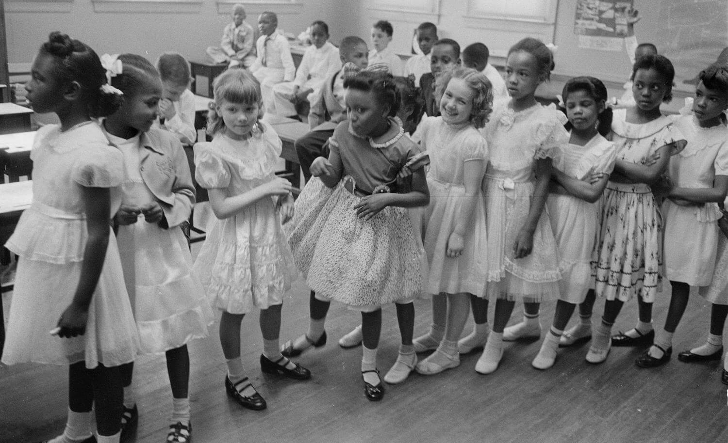 white and Black students attending school together; desegregation during the civil rights era
