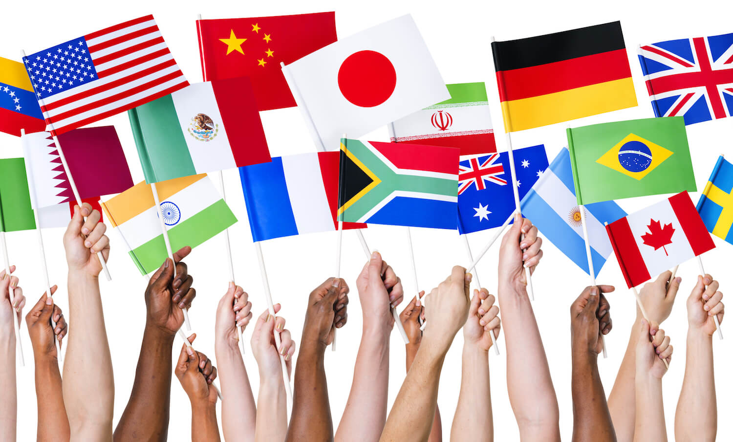 hands of various races hold up flags of different countries