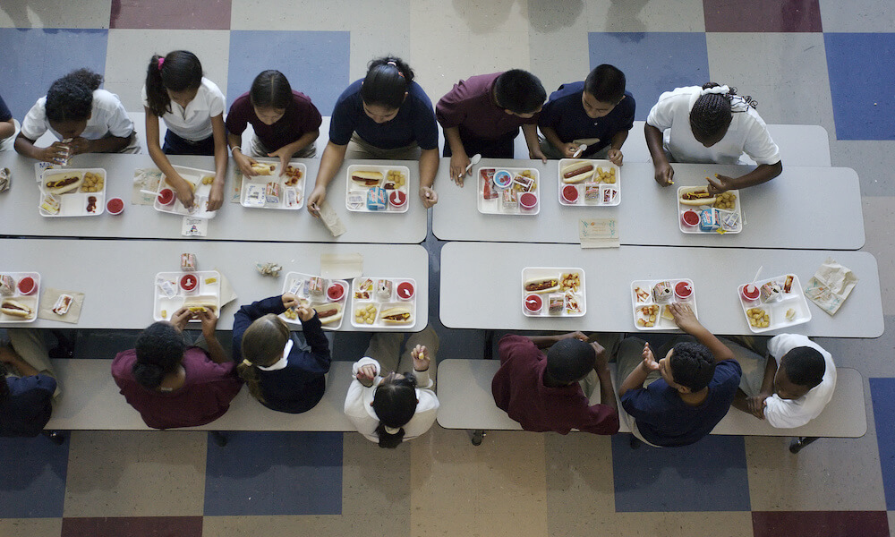Overhead view of students eating lunch in a school cafeteria