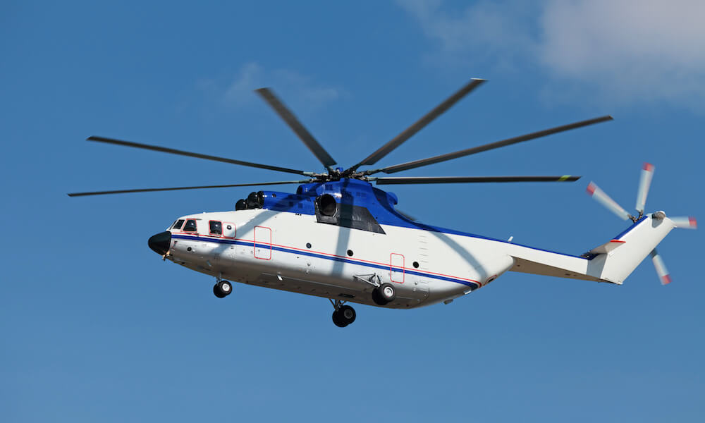 Heavy cargo helicopter, flying in the blue sky.
