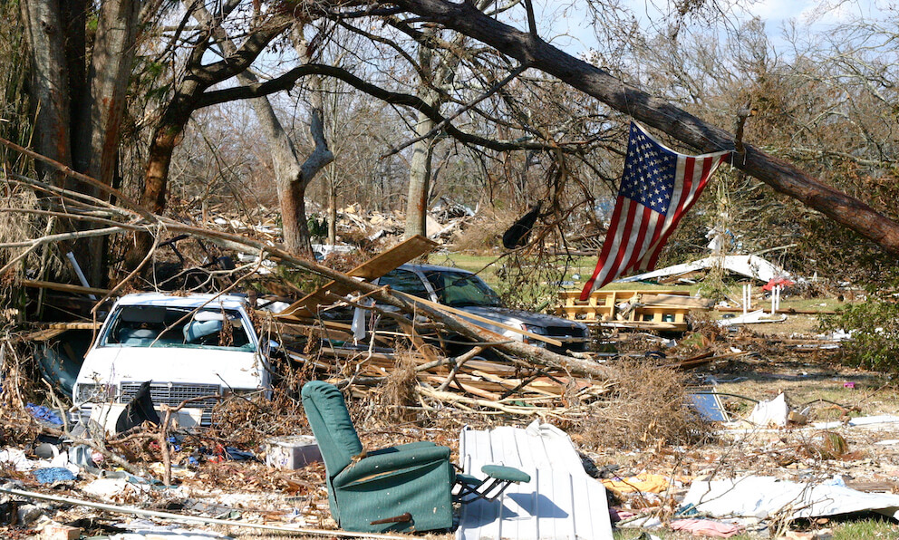 damage following a hurricane: destroyed property and fallen trees