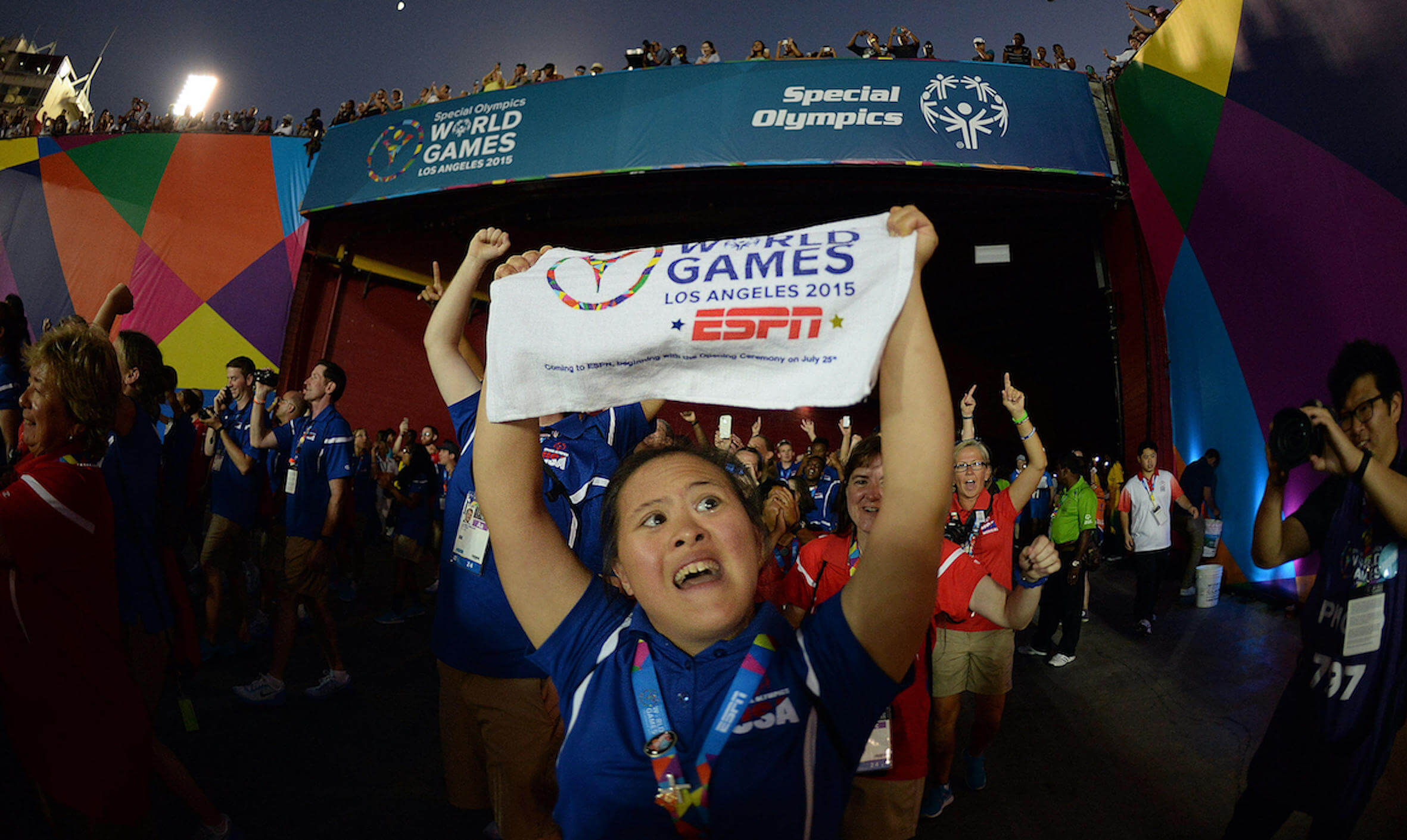 a U.S. athlete holds up a sign in celebration during the Special Olympics World Games