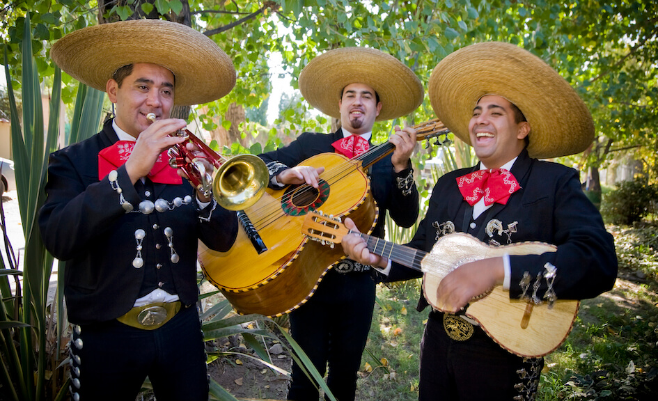 Mariachi Band members play a trumpet and guitars