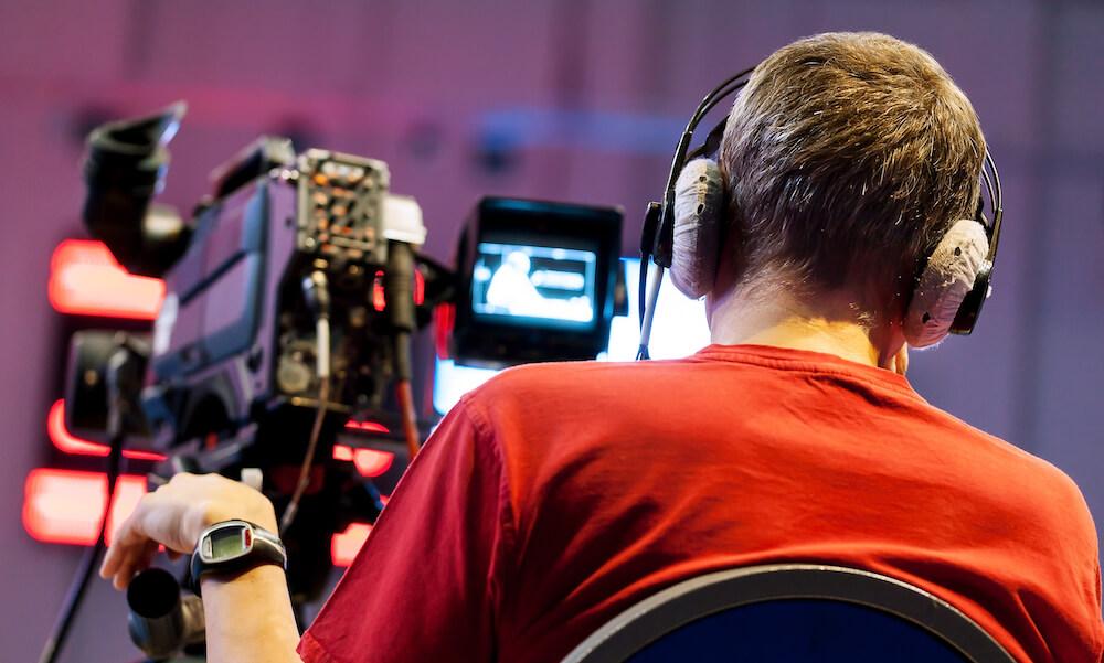 Professional cameraman wearing headphones