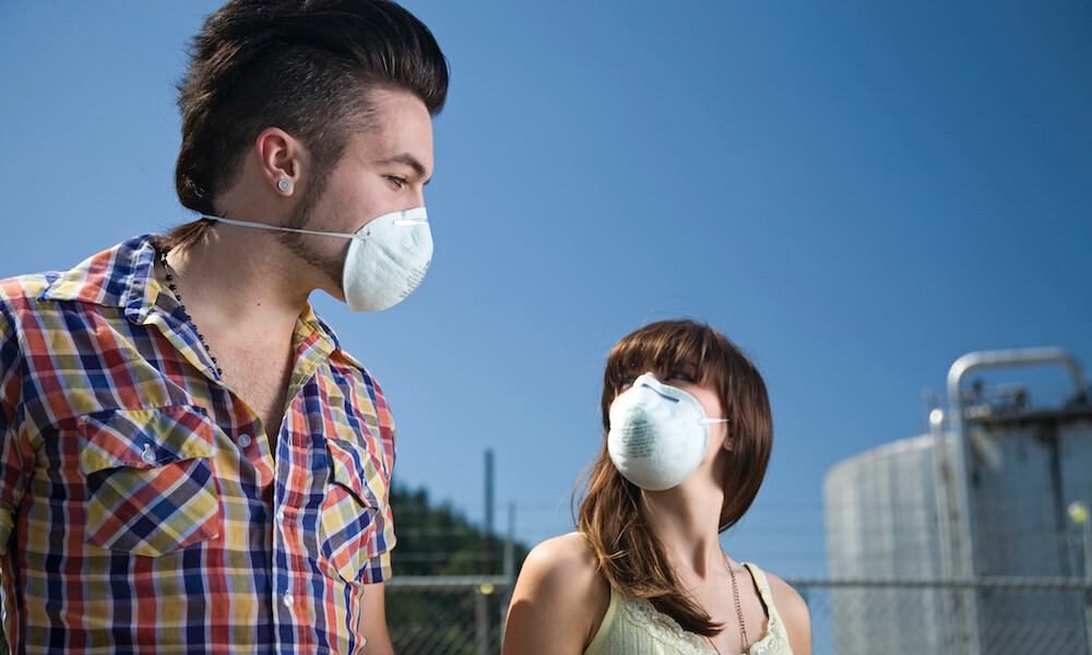 Young adults wearing dust mask to protect against air pollution