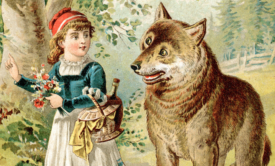 a vintage drawing of a little girl with a red cap next to a big wolf