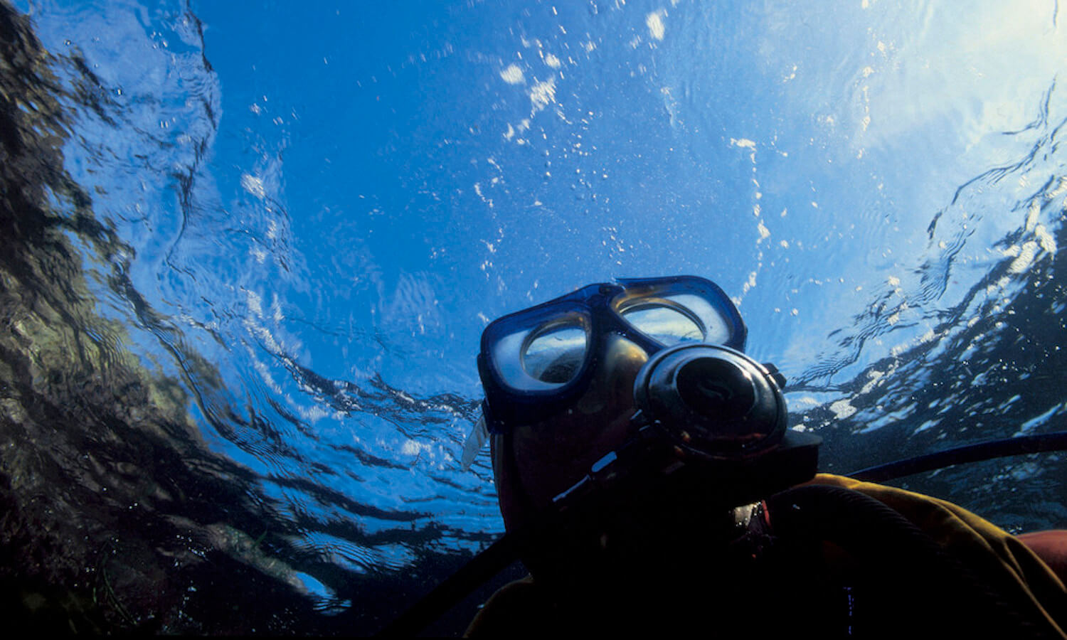 close-up of a scuba diver ascending to the surface