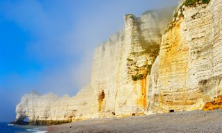 White chalk cliffs and pebble beach, Etretat, Normandy, France