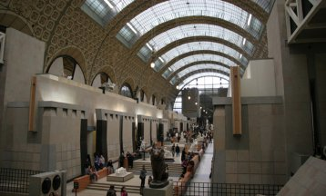 people walking through the Musée D'Orsay museum in Paris