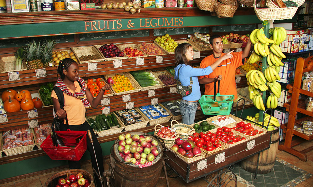Three students shop for food in J. A. Moisan's grocery store in Quebec City, Canada