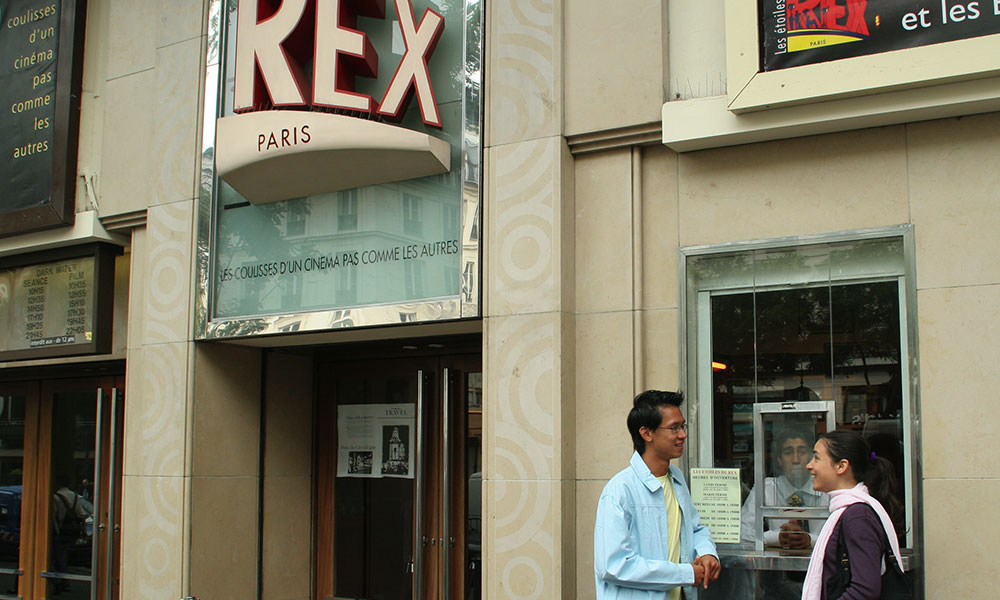 teens at ticket window for a movie theater