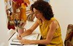 Businesswoman Writing on a Calendar