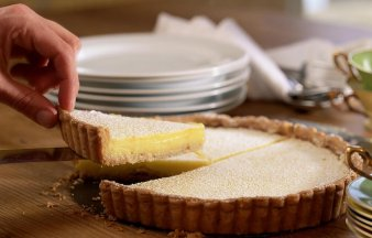 Removing a slice of lemon pie