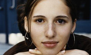 Portrait of a teenage girl wearing large hoop earrings