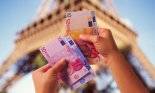 hands Euro dollars Eiffel Tower People Things Body Parts Paper Money