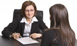 Two businesswomen at an interview in an office