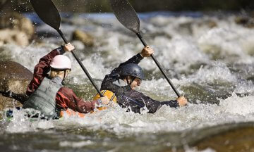 Kayakers Maneuvering Into Whitewater