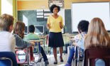 Female African American teacher standing, talking to class