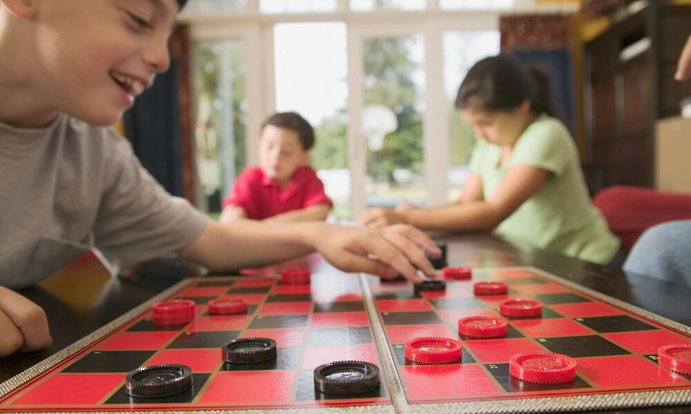 Children playing checkers