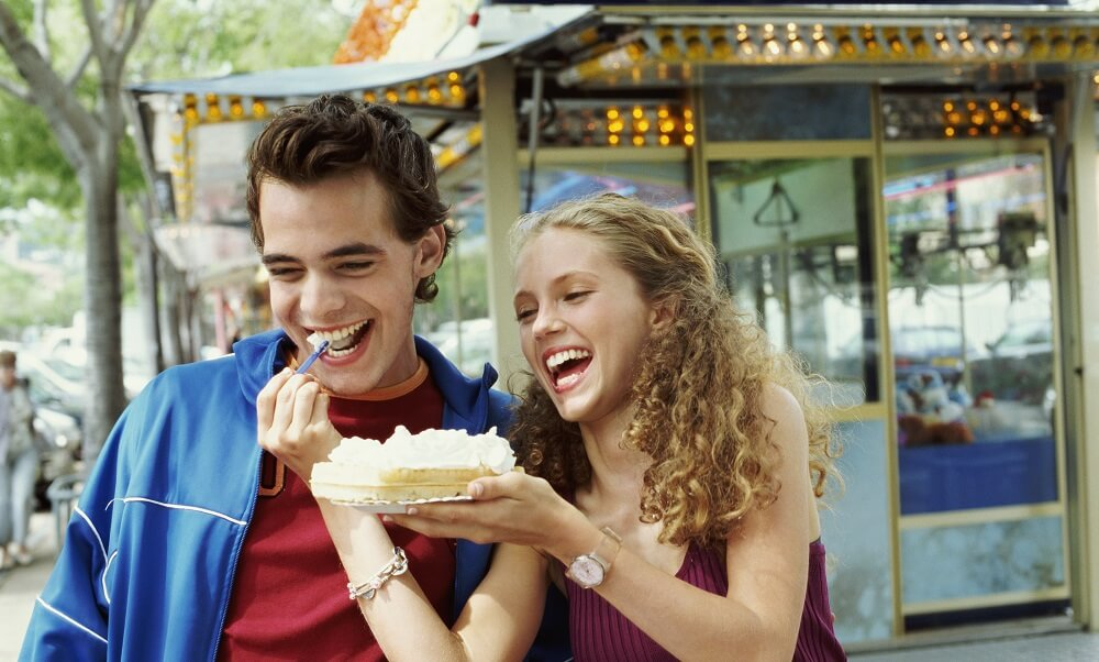 Couple sharing a waffle on a paper plate