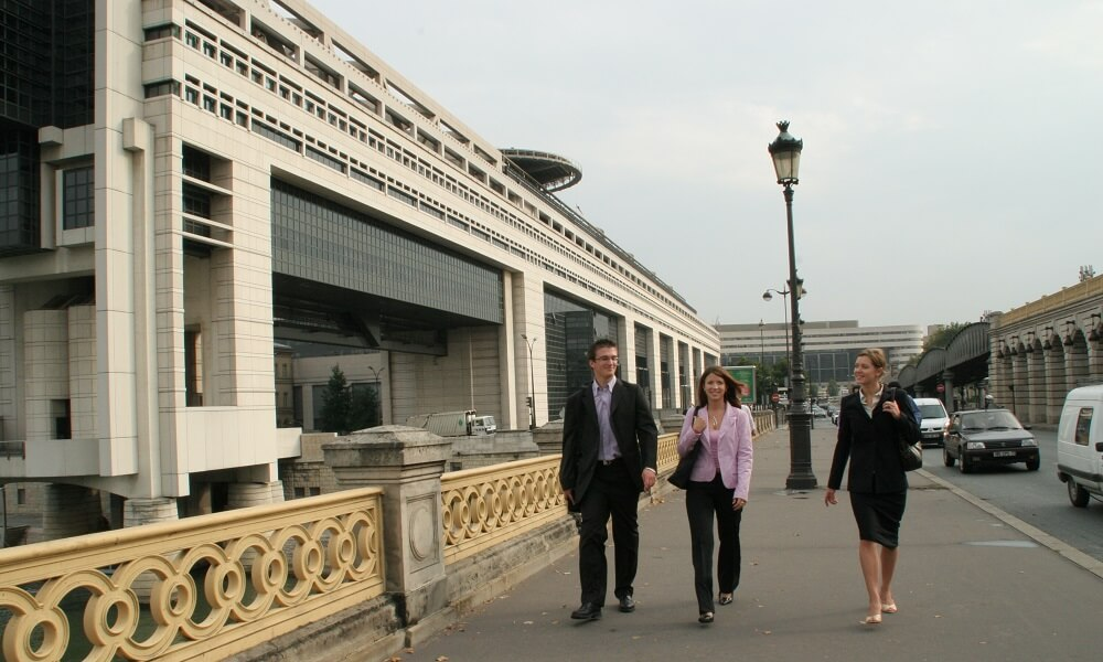 Business people on walkway in Paris