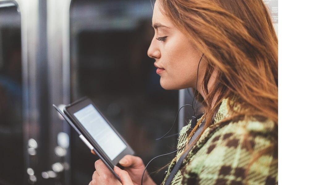 Woman reading e-book on subway