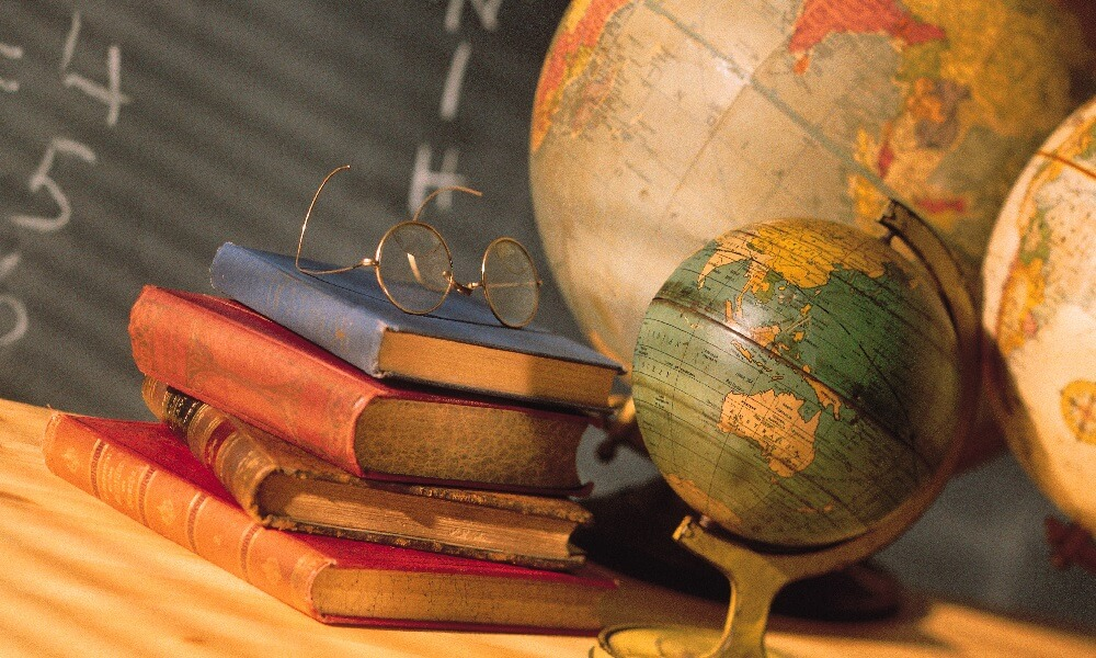 Books and globes on school desk