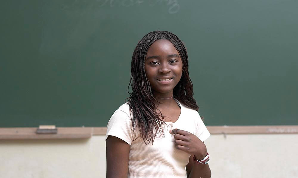 Girl in front of blackboard