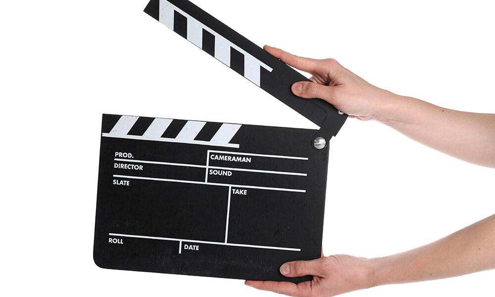 Hand holding film slate