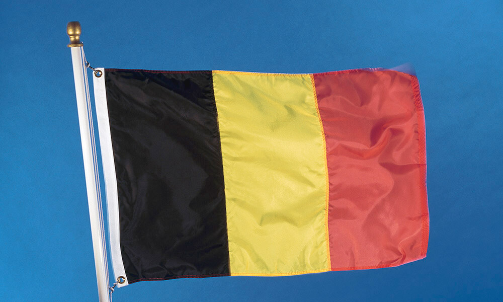 National flag of the Kingdom of Belgium on flagpole, waving