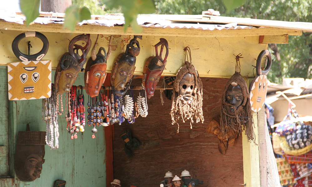 African masks in open-air market, Senegal