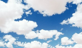 A blue sky with fluffy white clouds.