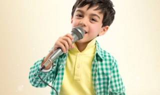 A boy singing into a microphone.