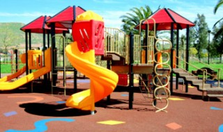 A colorful playground, with slides and climbing frames.