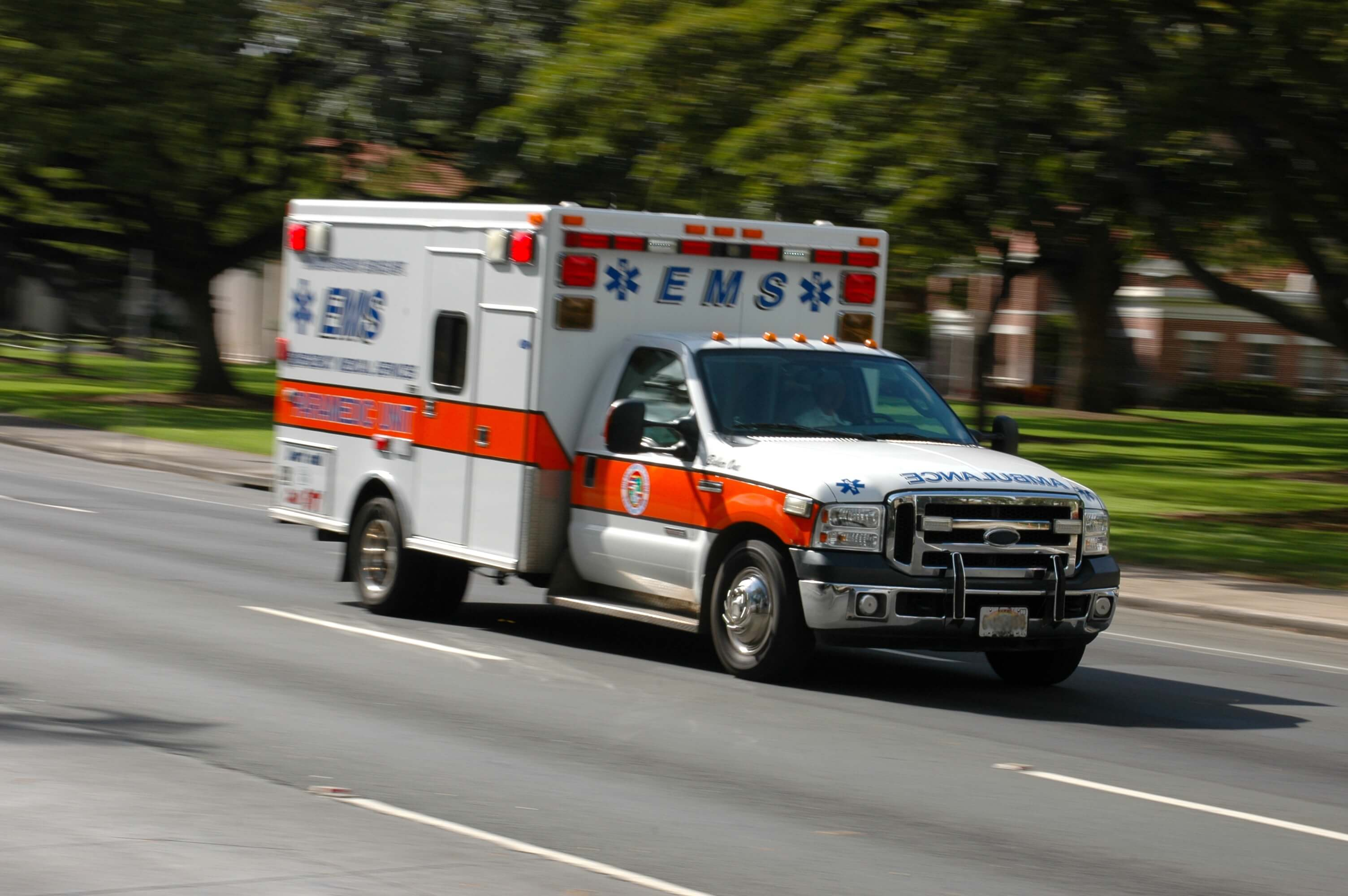An ambulance rushes to help someone.