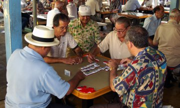 Men playing dominoes in Miami, FL