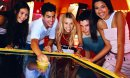 Five teenagers playing air hockey