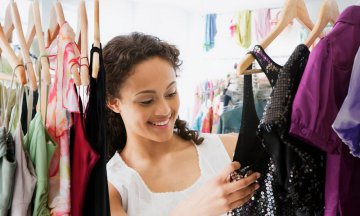 Mixed race teenage girl in dress shop