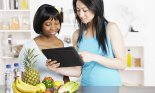 Dietician Showing Client Diet/ Food Plan On A Digital Tablet