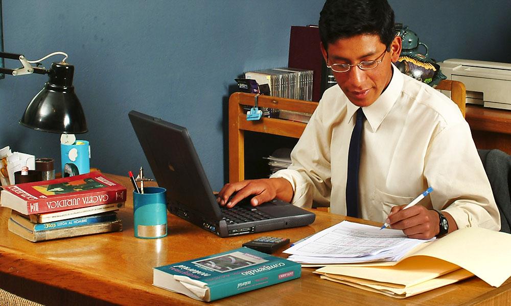 Man working in office, Cuzco, Peru